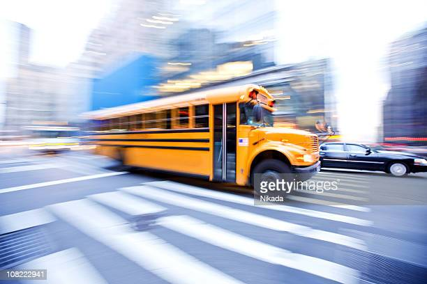 Motion Blur of School Bus in City