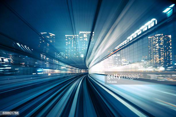 motion blur of train moving to city - electricity stock pictures, royalty-free photos & images