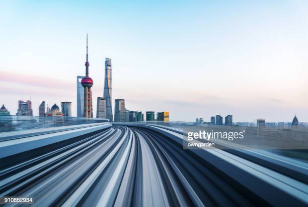motion blur of train moving to city - china stock photos and pictures
