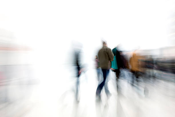 """""""Commuters Rushing in Corridor, White Background, Motion Blur"""""""