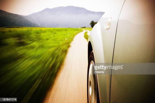 Motion blurred car drive on asphalt road