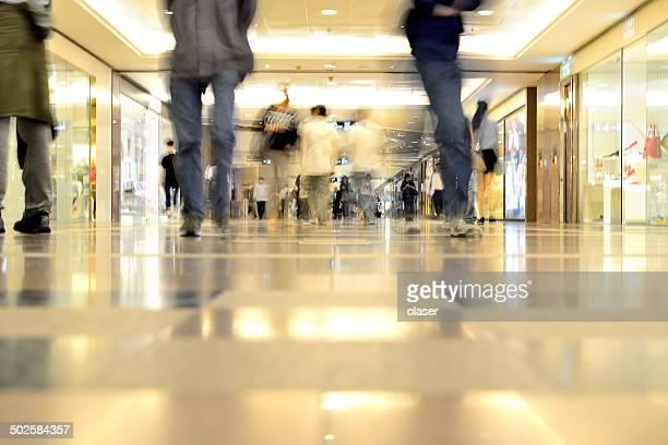 motion blurred customers walking in shopping mall, hong kong - fashion hong kong stock photos and pictures