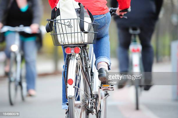 Motion blurred female bicyclist in bike traffic