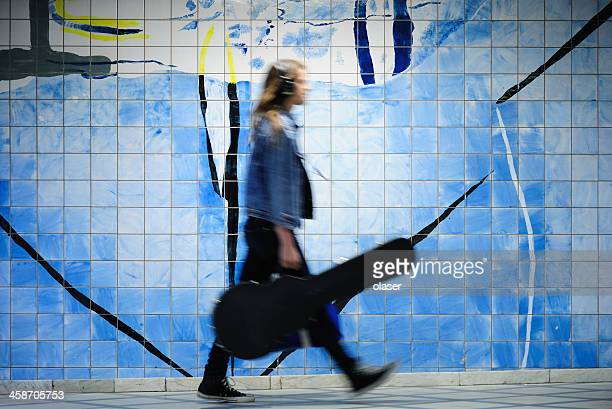 motion blurred man walking in the underground - guitar case stock pictures, royalty-free photos & images