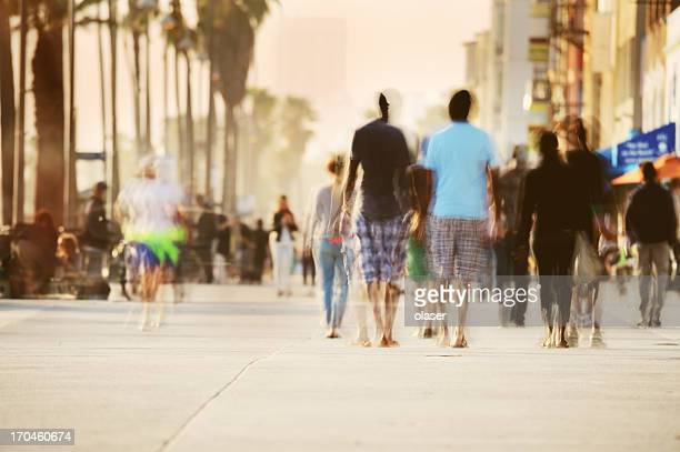 motion blurred pedestrians on boardwalk - boardwalk stock pictures, royalty-free photos & images