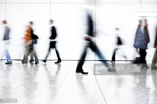 motion blurred people walking down corridor - motion stockfoto's en -beelden