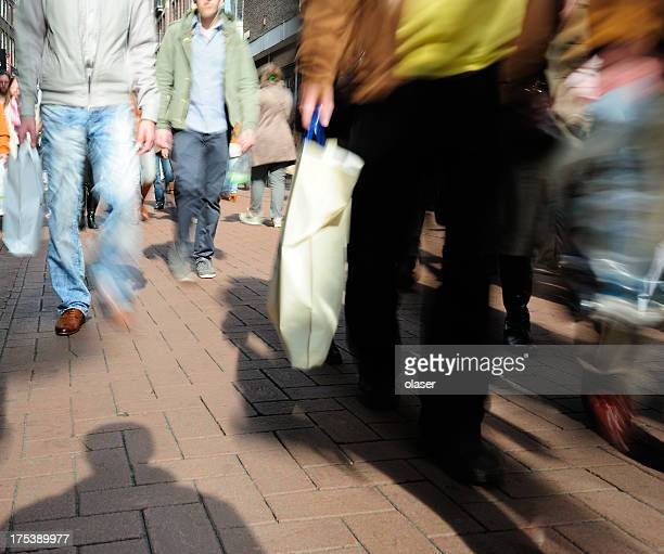 Motion blurred picture of people walking on street