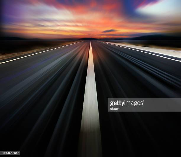 motion blurred road and dramatic sky - dividing line road marking stock pictures, royalty-free photos & images