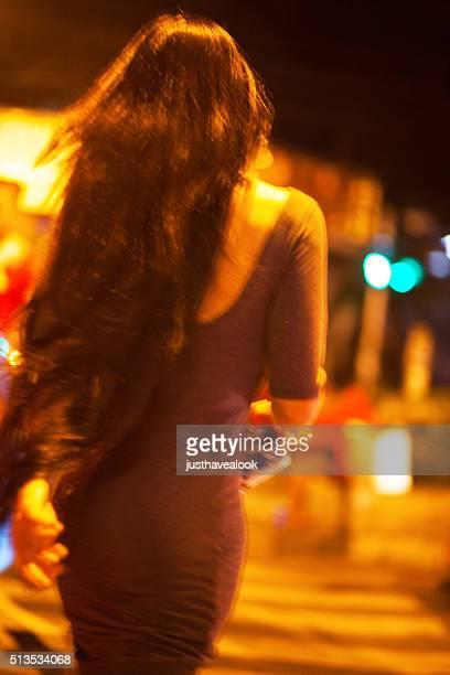 Motion blurred shot of walking thai woman