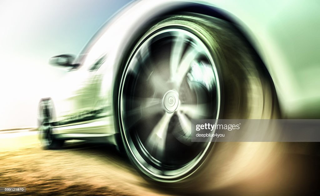 Motion blurred sports car tire : Stock Photo