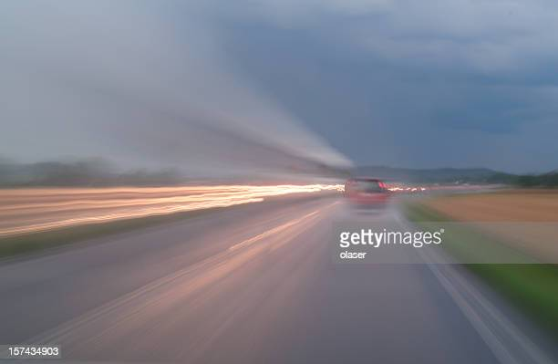 Motion blurred traffic in heavy rain weather