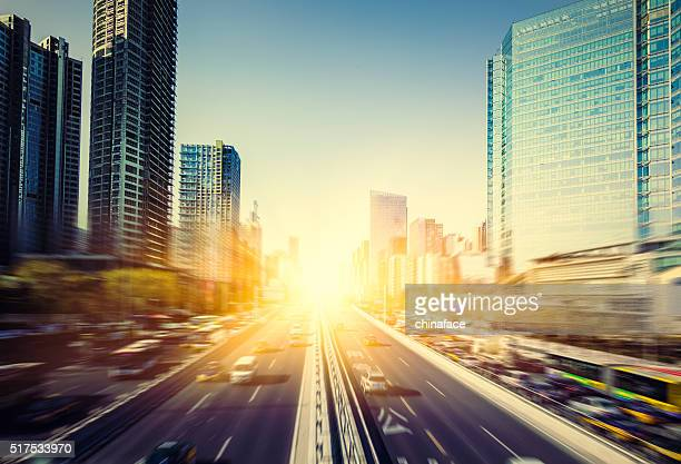 motion cars go through city - day stock pictures, royalty-free photos & images