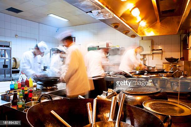motion chefs of a restaurant kitchen - chinese culture stock pictures, royalty-free photos & images