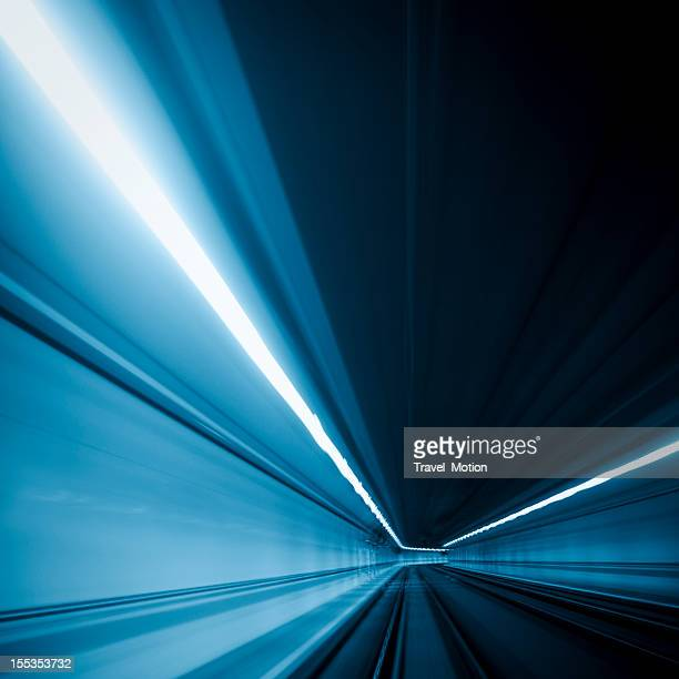 Motion photo of blue light traveling through a tunnel