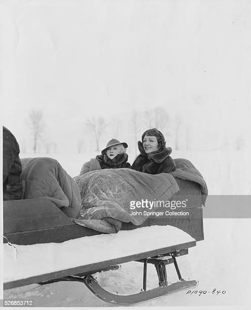 Motion picture actress Claudette Colbert takes a sleigh ride with her mother in Sun Valley Idaho while on location to shoot winter scenes for her...