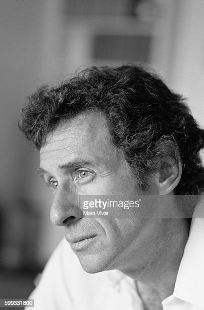 Motion picture director Arthur Penn director of Bonnie and Clyde relaxes on a sofa