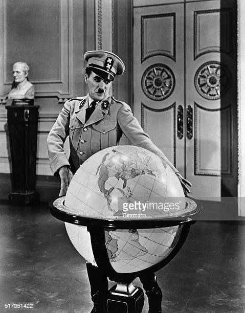 Motion picture still with Charlie Chaplin playing Adenoid Hynkel dictator of the fictional country of Tomania