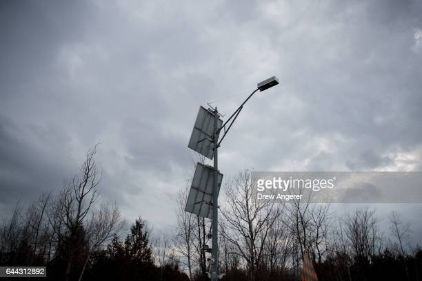 Motion sensor detecting and lighting equipment stands at the USCanada border February 23 2017 in Hemmingford Quebec In the past month hundreds of...