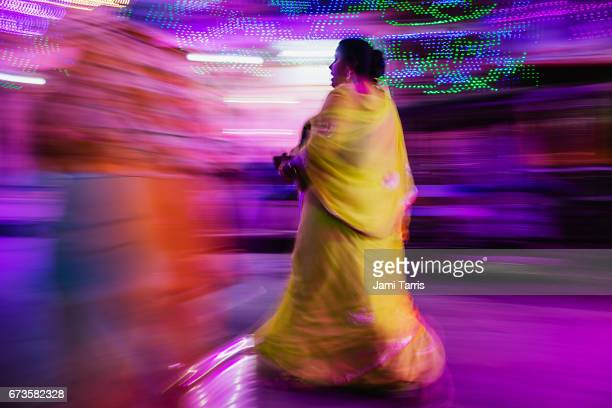 Motion-blur of a woman walking in colorful sari