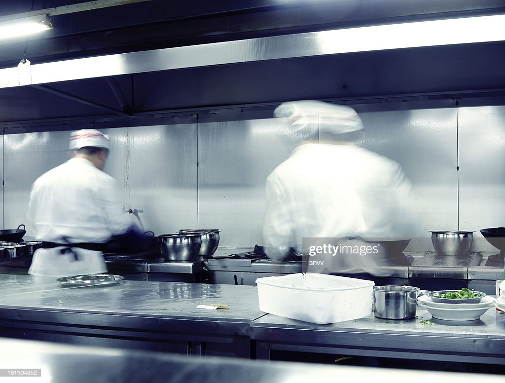Motionblurred Chefs Working In A Restaurant Kitchen Stock Photo ...