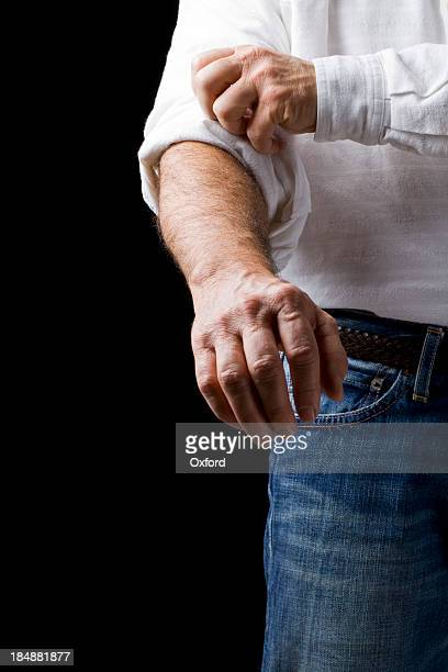 motivation: rolling up sleeve - rolled up sleeves stock pictures, royalty-free photos & images