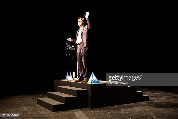 A motivational guru is standing on a podium to address an audience of Ernst Young staff during their annual Academy Day held for 3000 of company...