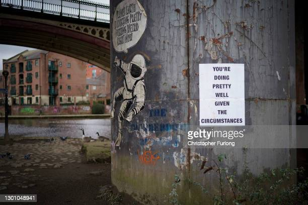 Motivational poster adorns a pillar in the Castlefield area on February 08, 2021 in Manchester, United Kingdom. With a surge of covid-19 cases fueled...