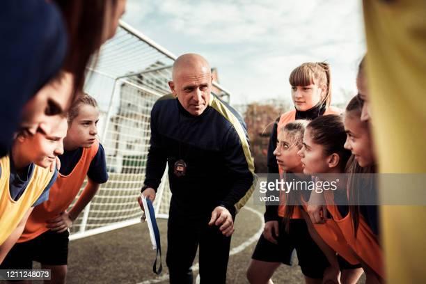 motiverende toespraak - voetbalteam stockfoto's en -beelden