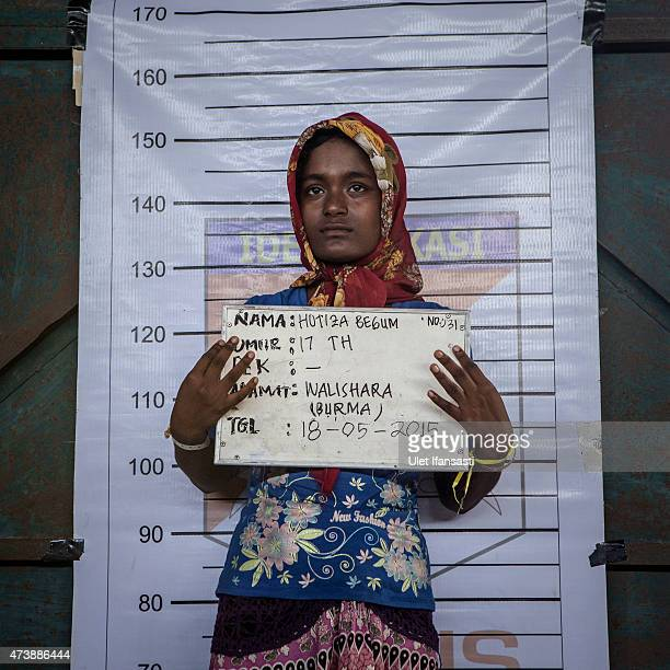 Motiza Begum A Rohingya migrant girl poses for identification purposes at a temporary shelter on May 18 2015 in Kuala Langsa Aceh province Indonesia...