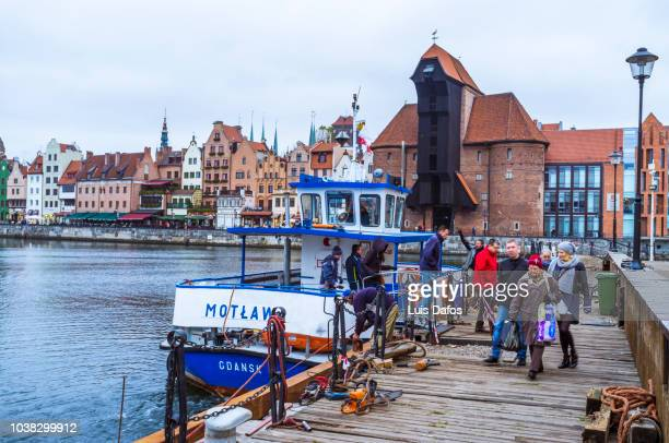 motlawa ferry and medieval crane - dafos stock photos and pictures
