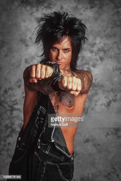 LOS ANGELES APRIL 25 Motley Crue bassist Nikki Sixx poses for a tattoo related session in Los Angeles on April 25 1997