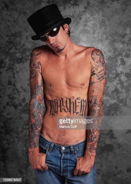 LOS ANGELES APRIL 25 Motley Crue Drummer Tommy Lee poses during a tattoo related portrait session Los Angeles California on April 251997