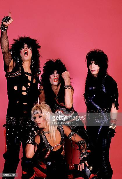 Photo of Vince NEIL and MOTLEY CRUE and Tommy LEE and Nikki SIXX and Mick MARS Posed group shot studio L R Nikki Sixx Vince Neil Tommy Lee Mick Mars