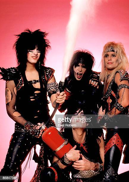 Photo of Vince NEIL and MOTLEY CRUE and Tommy LEE and Nikki SIXX and Mick MARS Posed group shot studio L R Nikki Sixx Mick Mars Tommy Lee Vince Neil