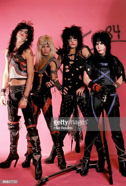 Photo of Vince NEIL and MOTLEY CRUE and Tommy LEE and Nikki SIXX and Mick MARS Posed group shot studio L R Tommy Lee Vince Neil Nikki Sixx Mick Mars