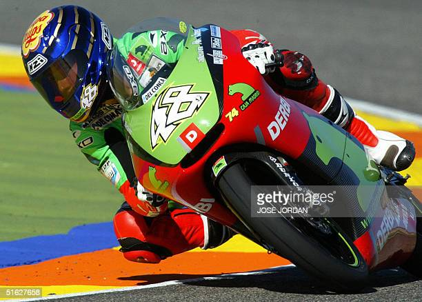 Moto 125cc Spanish rider Jorge Lorenzo takes a curve during a practice session for Spanish Motorcycle Grand Prix at the Ricardo Tormo racetrack in...