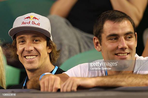 Moto Cross rider Robbie Maddison and NRL player Cameron Smith watch the quarterfinal match between Novak Djokovic of Serbia and Tomas Berdych of the...