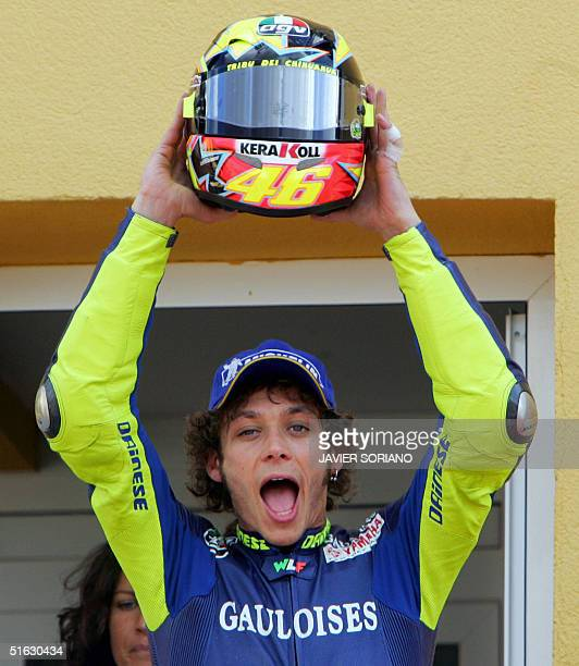 Moto GP Italian World Champion, Valentino Rossi lifts his helmet as he celebrates on the podium of the GP race of the Spanish Motorcycle Grand Prix...