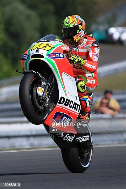 Moto GP rider Valentino Rossi of Italy wheelies his Ducati bike during the free practice session at the Czech Republic Grand Prix in Moto GP on...