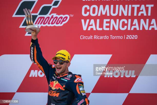 Moto2 rider Jorge Martin of Spain and Red Bull KTM Ajo shows his trophy for his win on the podium during the MotoGP of Comunitat Valenciana at...