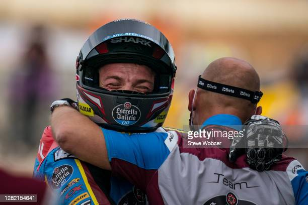 Moto2 rider Sam Lowes of Great Britain and EG 0,0 Marc VDS celebrates with his mechanic after entering parc ferme during the MotoGP of Teruel at...