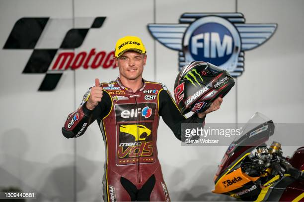 Moto2 rider Sam Lowes of Great Britain and Elf Marc VDS Racing Team celebrates his pole position at parc ferme during qualifying session at Losail...