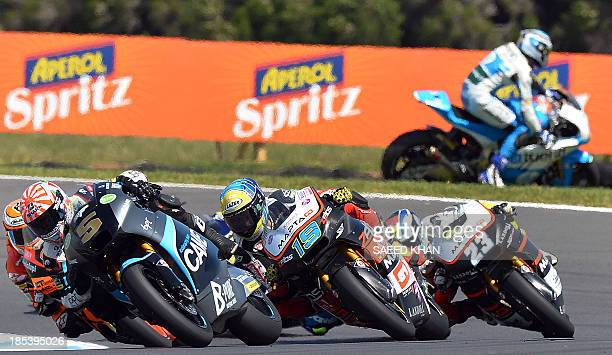 Moto2 riders take a corner as Spanish rider Axel Pons of the Tuenti HP 40 team runs off the track during the Moto2 race at the Australian Grand Prix...