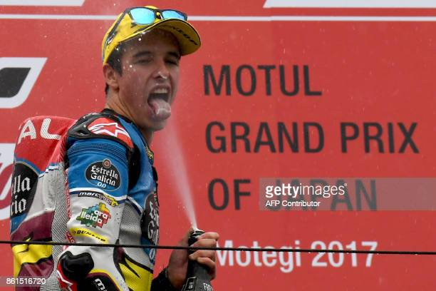 Moto2class winner Kalex rider Alex Marquez of Spain sprays champagne on the podium during the MotoGP Japanese Grand Prix at Twin Ring Motegi circuit...