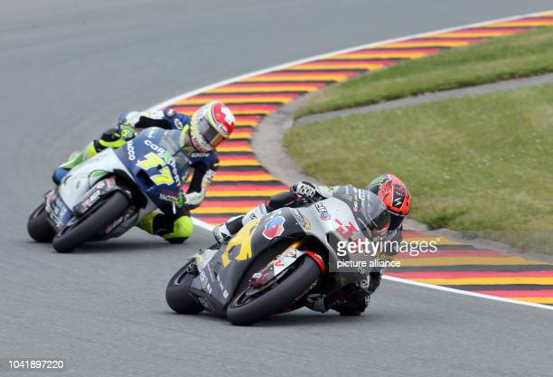 Moto2Fahrer Mika Kallio from the Marc VDS Racing Team and Swiss Dominique Aegerter from the Technomag carXpert team during the German Motorcycling...