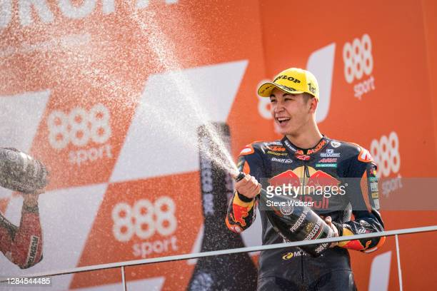 Moto3 race winner Raul Fernandez of Spain and Red Bull KTM Ajo celebrates with champaign his first victory during the MotoGP of Europe at Comunitat...