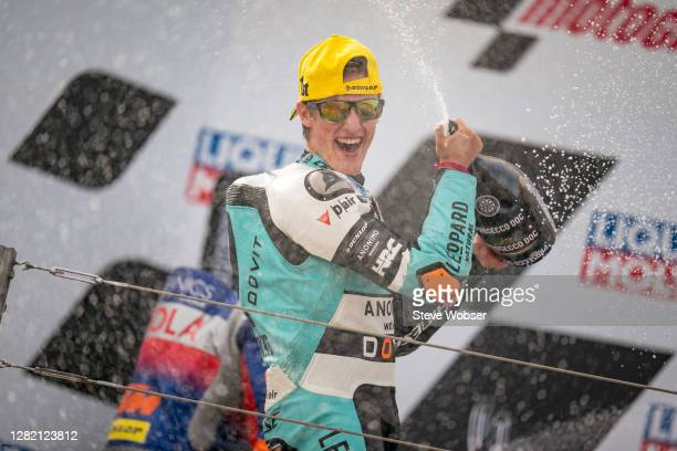 Moto3 rider Jaume Masia of Spain and Leopard Racing celebrates his win with champagne at the podium during the MotoGP of Teruel at Motorland Aragon...