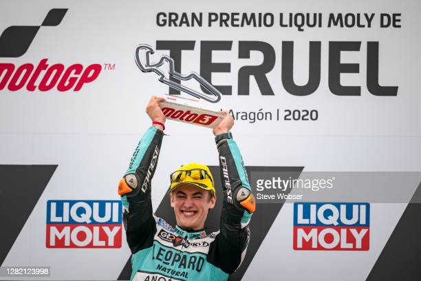 Moto3 rider Jaume Masia of Spain and Leopard Racing smiles with his trophy in his hands on the podium during the MotoGP of Teruel at Motorland Aragon...