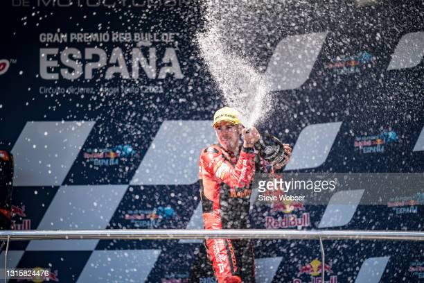 Moto3 rider Jeremy Alcoba of Spain and Indonesian Racing Gresini Moto3 with champaign on the podium after his third position during the Moto3 race at...