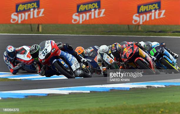 Moto3 riders take a corner during the Moto3 race at the Australian Grand Prix at Phillip Island on October 20 2013 AFP PHOTO / Saeed KHAN USE